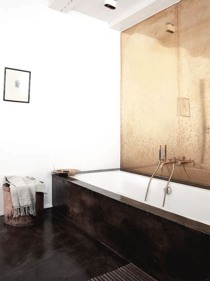 Copper wall painted/stained concrete, could get a similar effect with tile