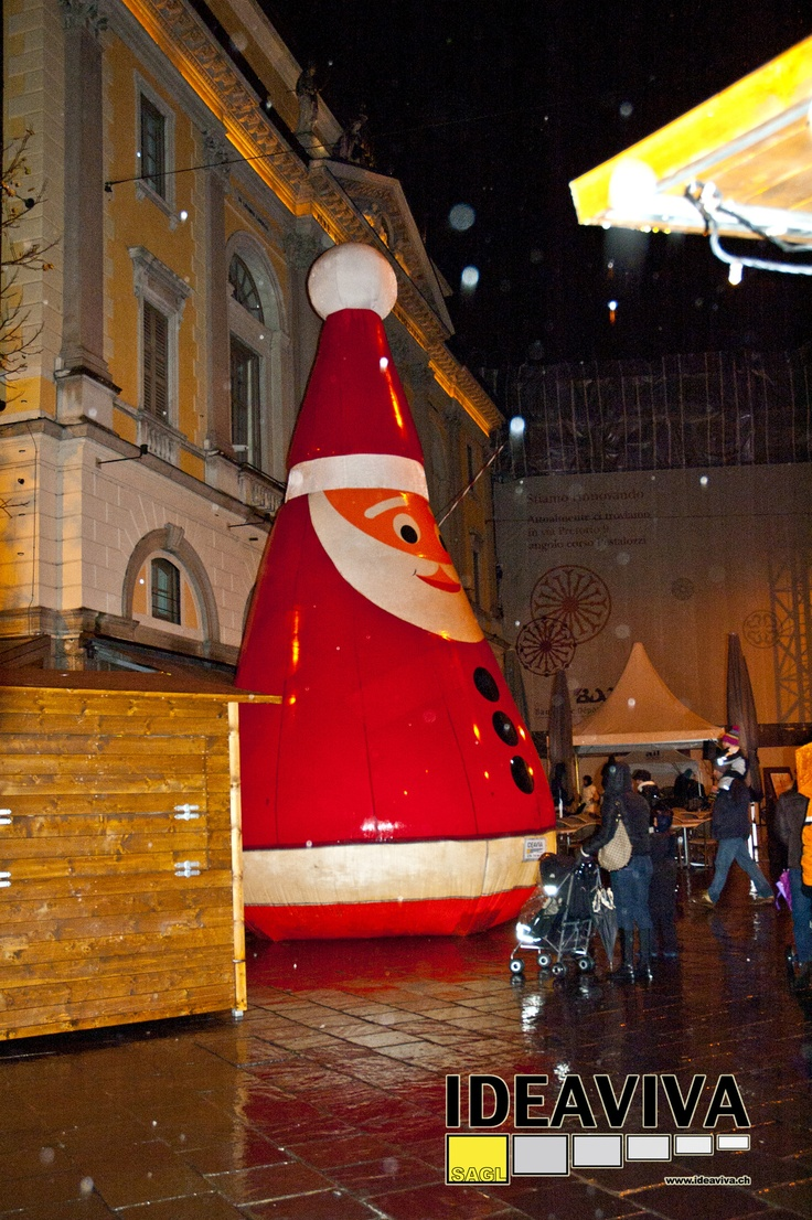 Christmas in Lugano, Piazza della Riforma with the big Santa Claus Ideaviva. Commissioned work from Lugano tourism and carried out consulting for carmelomeo Ideaviva sagl.