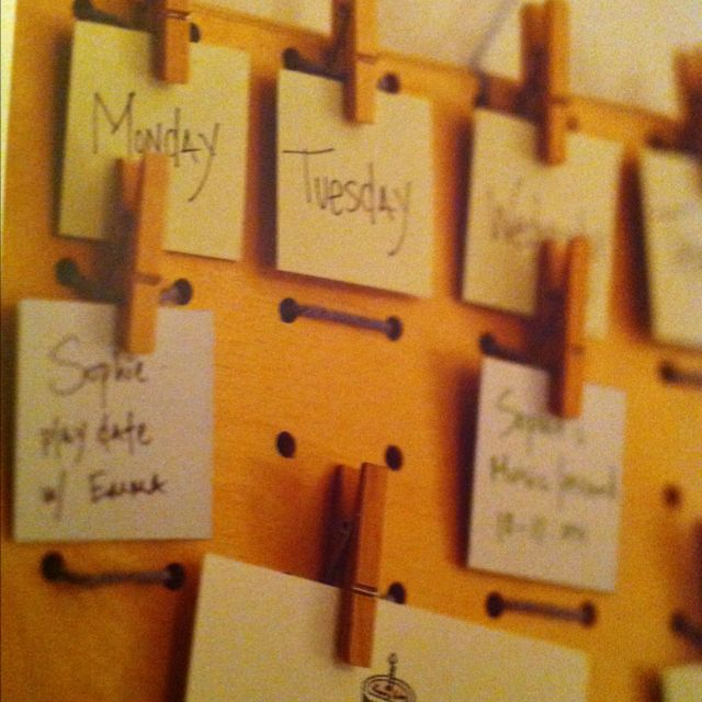Peg board with yarn and clothes pins as a memo board