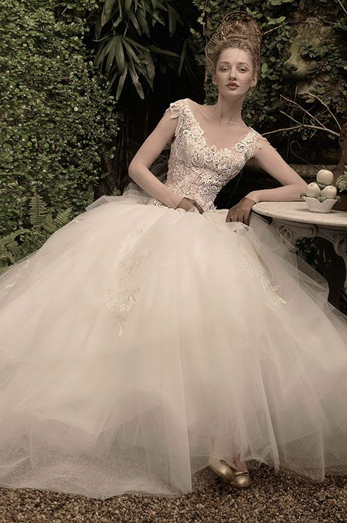 St. Pucchi, 2014 Beautiful dress. I want my reception to be in a garden like this