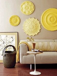 Painted ceiling medallions as wall art ambitious but quite elegant...