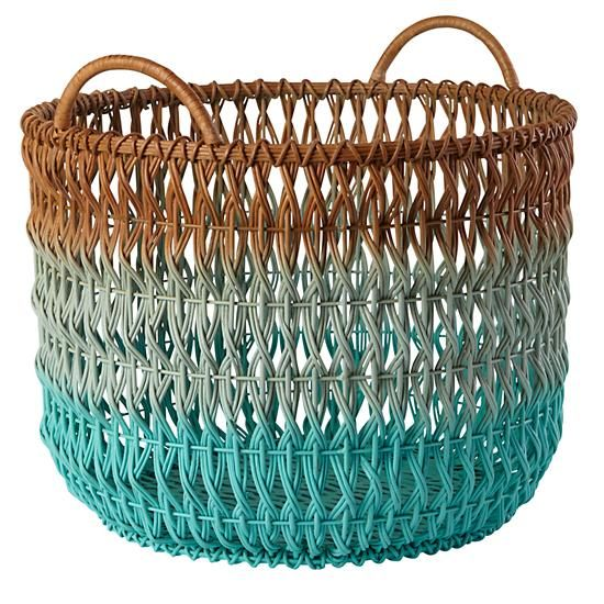 I'd get two of these to be used as hampers by each child's dresser. Ombre Rattan Floor Basket   The Land of Nod