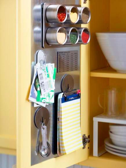 Use a sheet metal insert to turn the inside of a cabinet door into a convenient storage space with magnetic hooks, containers and clips. Click for 40+ more storage and organizing ideas!