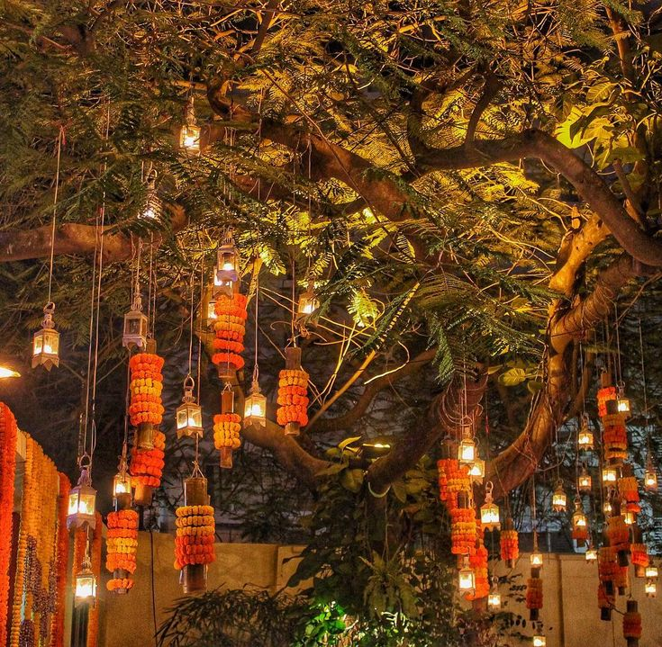 """""""Dreamy Jalan tree all dressed up for a magical evening. ✨Loved all the lights and flowers! #kolkata #wedding"""""""