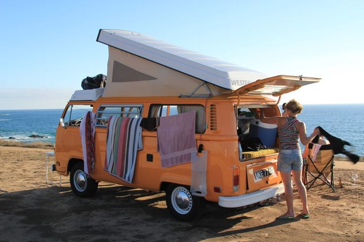 VW Camper van at the beach - top popped up