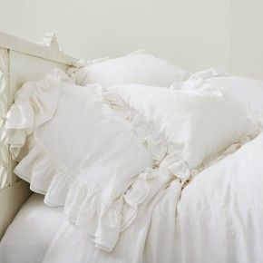 White Cotton-Silk Jacquard Pillowcases & Shams.  Very easy to modify plain pillow cases by creating ruffled edge using matching flat sheet (which fewer people use).