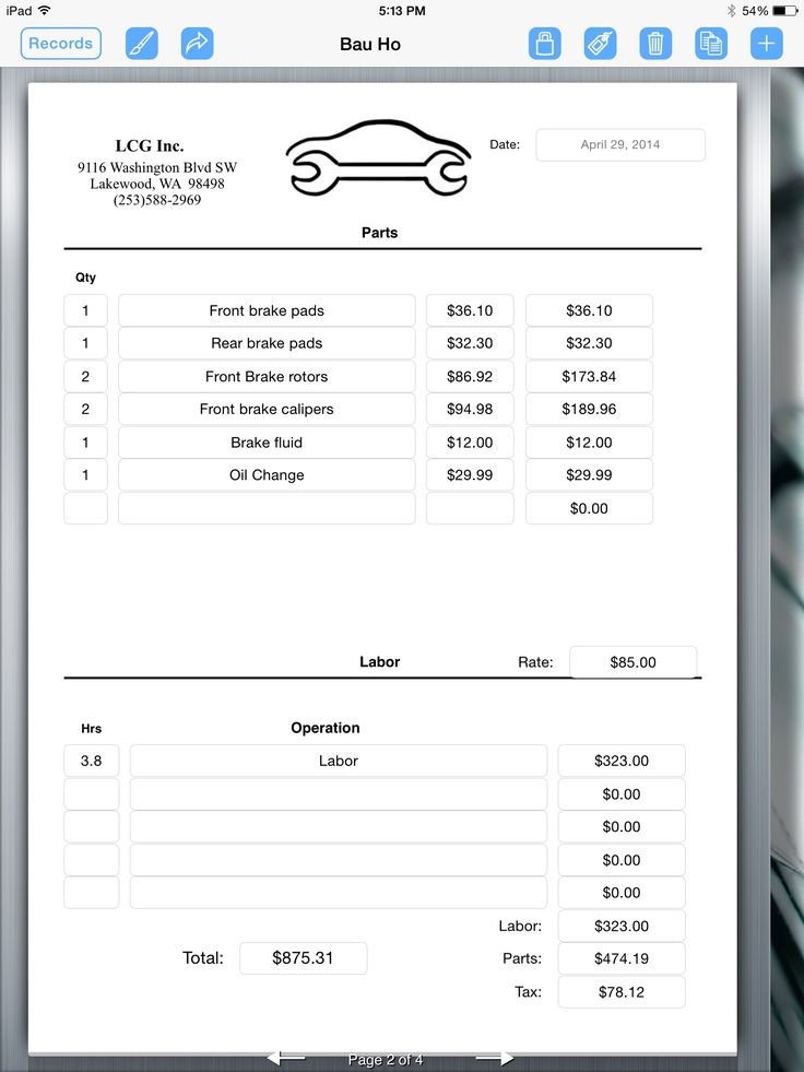 auto repair invoice auto repair service uses ipad for creating an - filling out an invoice