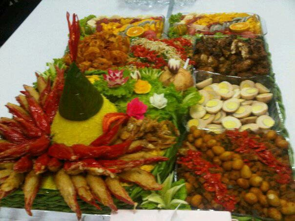 The traditional Nasi Tumpeng kuning (Coconut Yellow Rice) accompanied with egg, fried chicken, beef liver with potato in spicy sauce, fried soybean cake, shrimp cracker etc. The yellow color is made from curcuma. And the rice is made from Coconut Milk. This Nasi Tumpeng is made for special occasion to celebrate something such as birthday, wedding anniversary, farewell, baby shower etc.