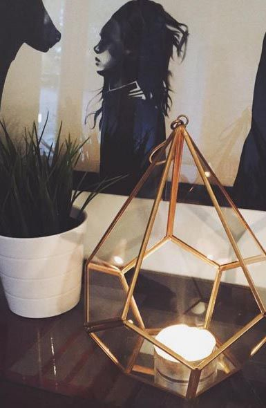 Create a unique miniature world, candle display feature or living art with our Hanging Gold & Glass Votive Lantern, an ornamental piece combining brass, glass and mirror in an unusual geometric design. image by inafotograf