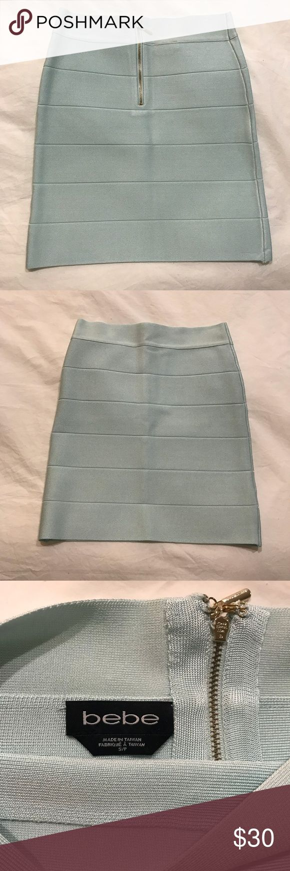 Bebe bodycon skirt Worn 1x. Like new! This slimming mini skirt is in a pale robins egg blue color — just gorgeous. The photos aren't really doing it justice and the shadows are making it seem dull but it's a bright yet pale aqua! Can be worn with a crop top in the summer or a sweater in the winter... try it with a sweater and high boots, one of my favorite looks! Pet free smoke free home :) bebe Skirts Mini