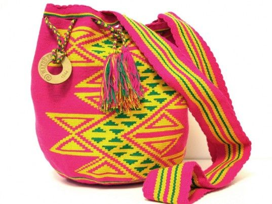 """Wayuu Taya Bags. Patricia Velasquez founded the Wayuu Taya Foundation in 2002 to improve the lives of the Wayuu, an indigenous group of over 450,000 people in Colombia and Venezuela, while providing an outlet for artistic expression. Each bag, known as a """"susu,"""" is one of a kind, taking 20 eight-hour days to create. All that work has its payoff, however: 90 percent of the proceeds goes back to the community. Buy them here http://wayuutaya.net/: Wayuu Taya, Diapers Bags, Wayuu Bags, Fashion Style, Taya Bags, Beautiful Bags, Colombia Venezuela, Http Wayuutaya Net, Ethicalfashion Artisan"""