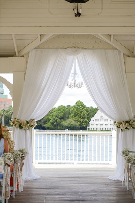 We are so in love with this wedding ceremony at Sea Breeze Point in Walt Disney World