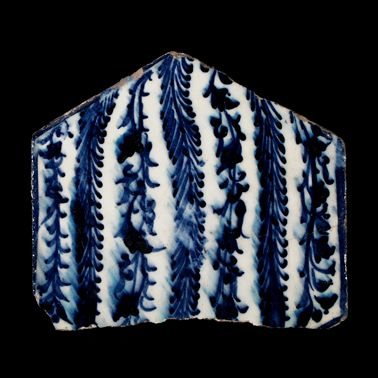 Egypt or Syria. A stone paste squared-off hexagonal tile painted in underglaze cobalt-blue. Chinese inspired foliate design. Early 15th century.Via http://anthonyslayter-ralph.com