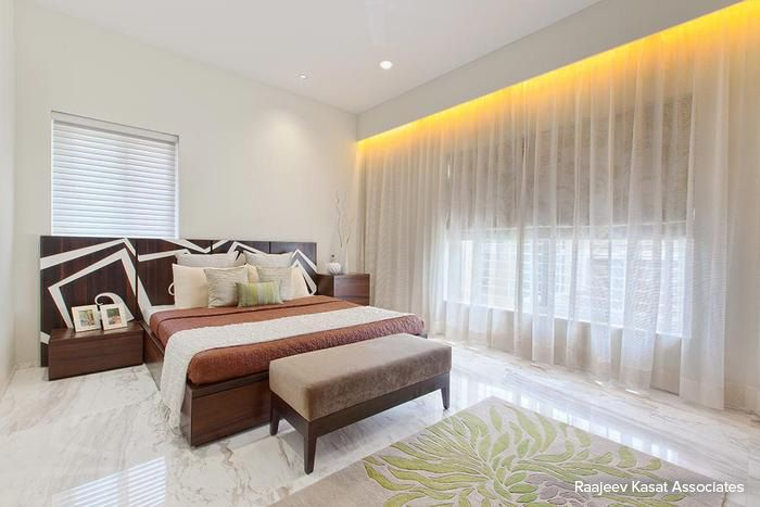 Transparent white curtains enhance the natural lighting within this peaceful bedroom #bedroom #homedecor #white #contemporary Design Courtesy - Raajeev Kasat Associates, Mumbai