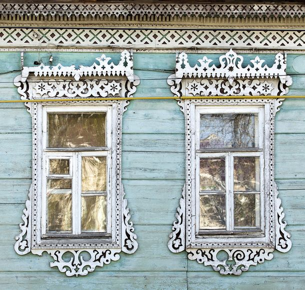 """Russian traditional architrave - ""nalichnik"" - still can be found even in a big cities. Some of those was made in XIX century. http://nalichniki.com/en/ """