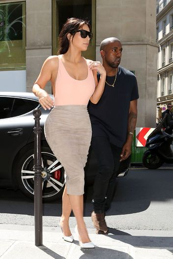 Kim Kardashian looking va-va-voom sexy in a bodysuit and pencil skirt