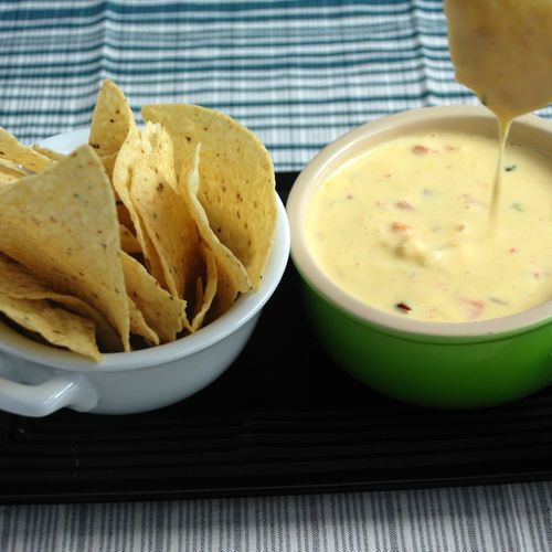 This recipe adds sodium citrate to a cheddar and Gouda cheeses to give it a modernist twist. The immersion blender makes the queso texture smooth, then add sweet shrimp, diced peppers and tomatoes. - Amazing Food Made Easy