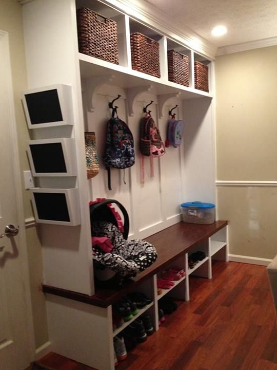 Mudroom/Homework Room Two levels of hooks for children, one high for jacket, one low for back packs