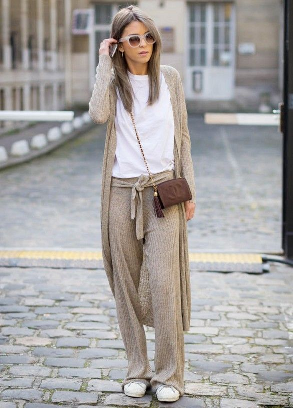 Light knit ensemble in oatmeal brown:  long length sweater and matching tie at waist trousers ...  (image from whowhatwear)