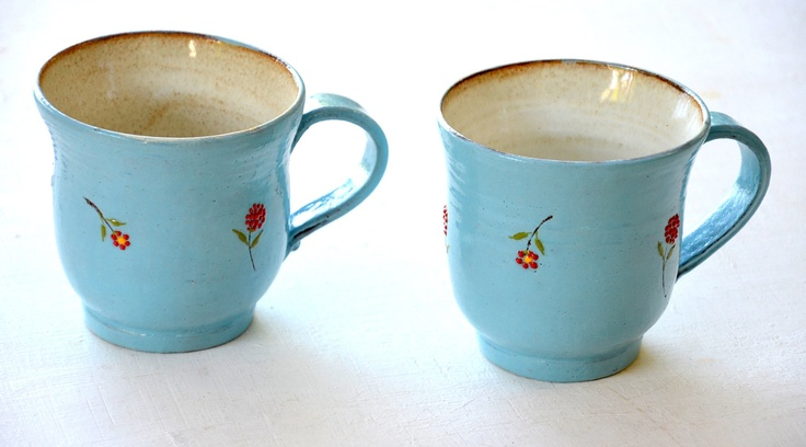Two sky-blue mugs decorated with red flowers. $44.00, via Etsy.