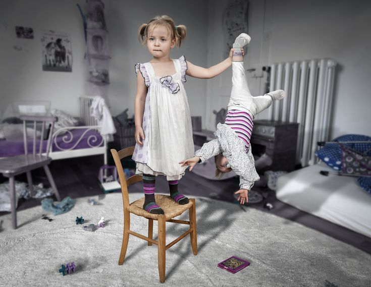 Don't touch my book... little sister! by John Wilhelm