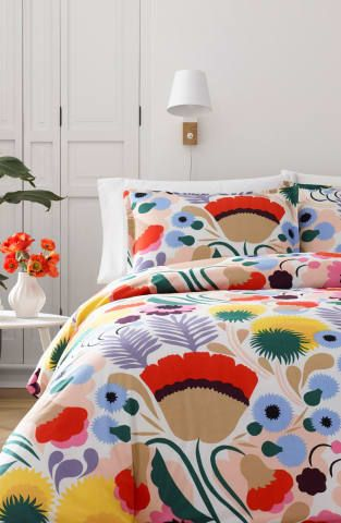 "Cheery, vibrant flowers explode across a standout comforter set offered by Marimekko, the Finnish design company established in 1951 and famous for joyful, splashy graphics and inventive textiles that embody the elevated everyday aesthetic of Finnish Modern design.  * 66"" x 86"" Twin; 92"" x 96"" Full/Queen; 106"" x 96"" King  * Twin set includes one standard sham; Full/Queen set includes two standard shams; King set includes two king shams  * 100% cotton  *..."
