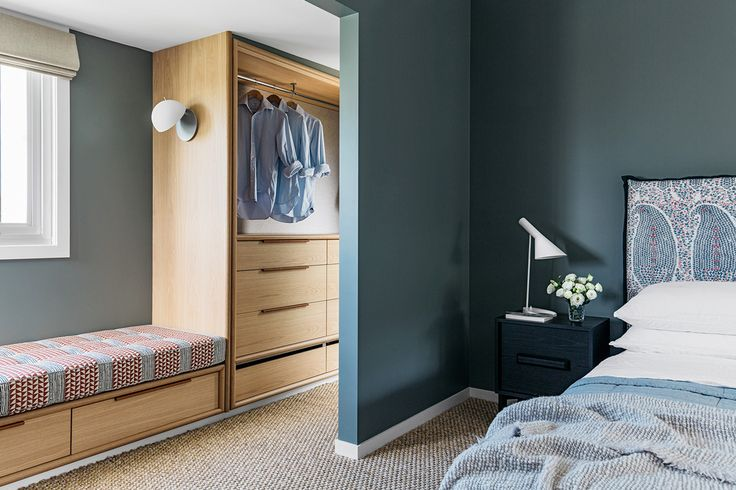 Macmasters Beach House | Arent & Pyne - separated storage and sleeping areas. Deep colour around the bed