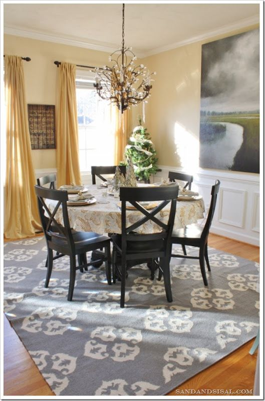 Ivoire by Sherwin Williams.  I like the wall paint for the family room. Love this rug!!!!