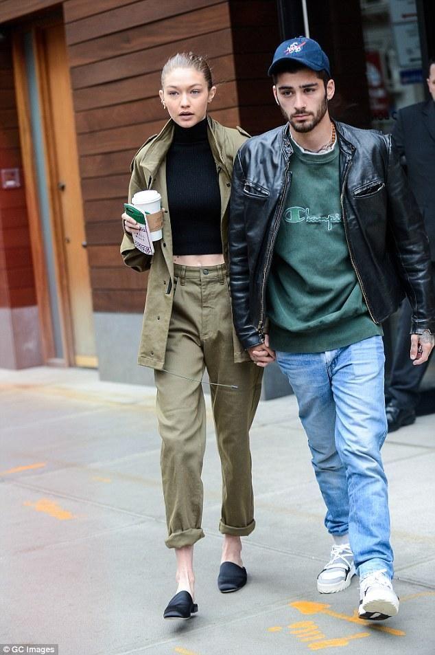 Gigi Hadid wearing Ban.do Chill Pills Iphone Case and Stuart Weitzman Black Satin Mulearky Flats