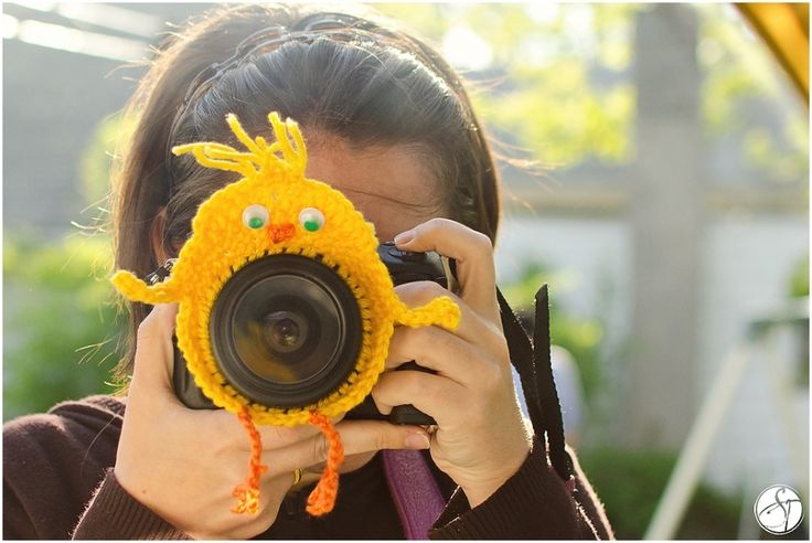 Crochet chick on the lens of the camera - say cheeeese