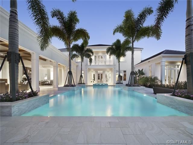 Cool blue pool travertine deck royal palm trees for Garden oaks pool