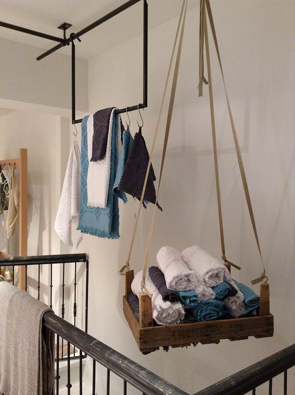 Hanging storage. Not sure how to apply this at home but have a feeling I could come up with something awesome: crates, hammocks, lines of pegs?
