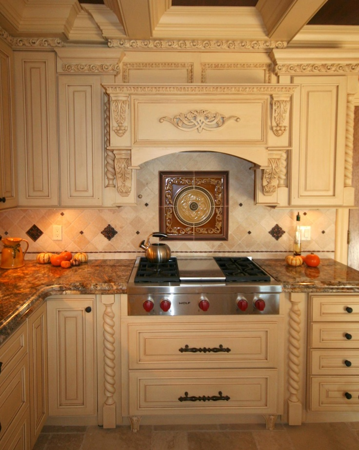 Ivory kitchen with decorative hood