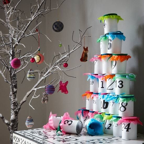 DIY Advent Christmas calendar: Recycle used food tins (after rinsing) by spraypainting them white and numbering them from 1 to 25. Line each with a brightly coloured tissue paper and a treat, then stack them up on a stable tabletop.