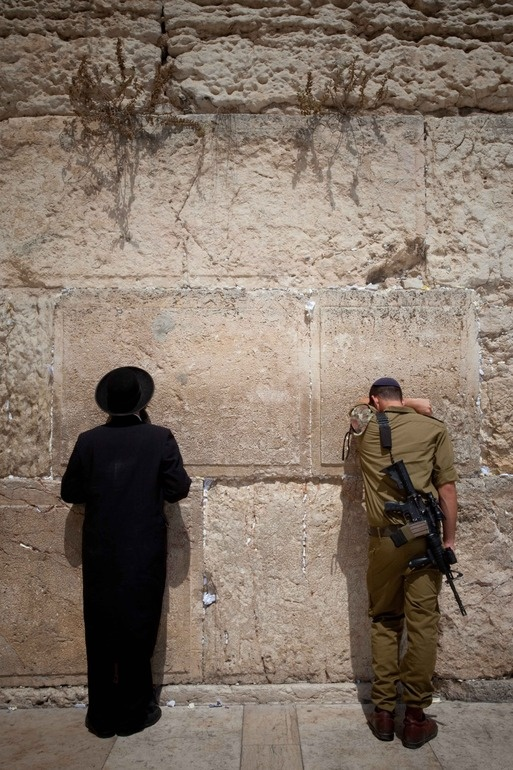 Saying a prayer at the Wailing Wall in Jerusalem...  (thought provoking..)