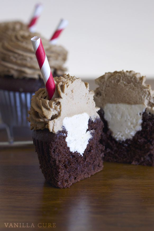 Root Beer Float Cupcakes Recipe - Moist chocolate-root beer cupcakes filled with creamy vanilla bean buttercream and topped with whipped root beer frosting! Tastes just like the real thing!