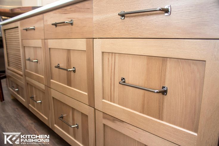Large charcoal contemporary hardware pulls from Amerock on hickory cabinets.