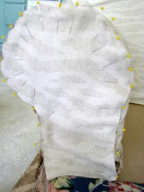 DIY:  How to Sew a Slipcover - this is an excellent, easy to follow tutorial that shows how to create a pattern and how to sew a slipcover.