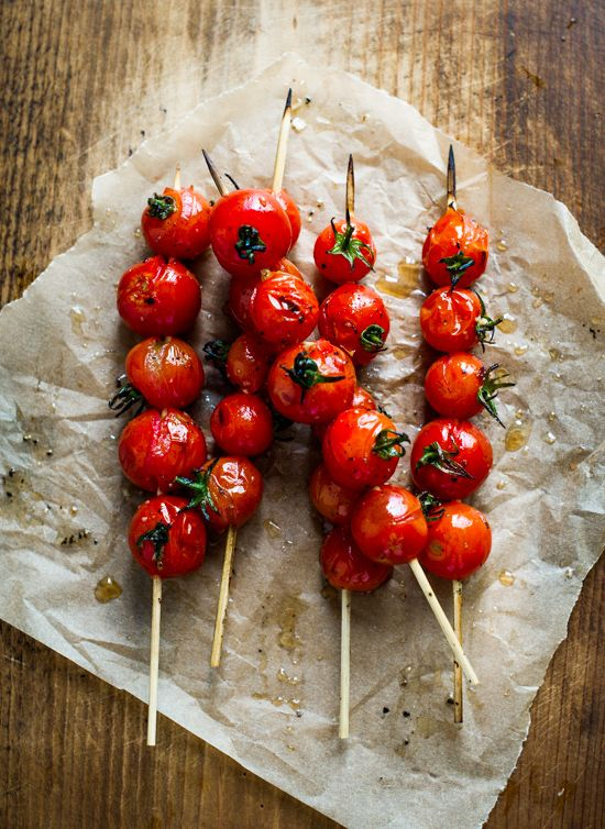 Grilled cherry Tomato Skewers - great idea! Sprinkle with olive oil and grill on bbq or in the oven. Season with pepper and herbs. Serve as a side or a snack.