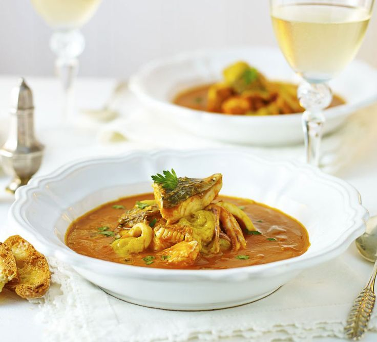Fish stew with roast garlic & saffron. Try this simpler, lighter version of bouillabaisse, a classic fish soup - serve with toasted slices of baguette to mop up the tomato based sauce