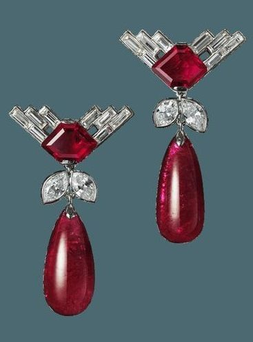 A pair of Art Deco platinum, ruby and diamond ear pendants, by Cartier London, circa 1931. Image source: Biennale des Antiquaires 2014, Paris.