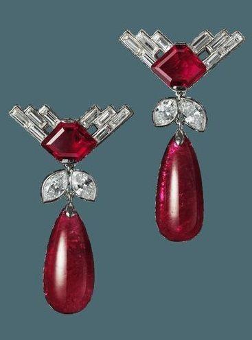 A pair of Art Deco platinum, ruby and diamond ear pendants, by Cartier London, circa 1931. Image source: Biennale des Antiquaires 2014, Paris.