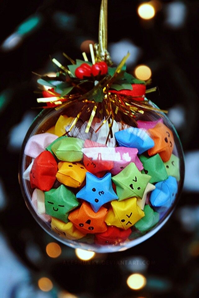 Kawaii paper stars in a glass Christmas tree ornament. Silly & cute! <3