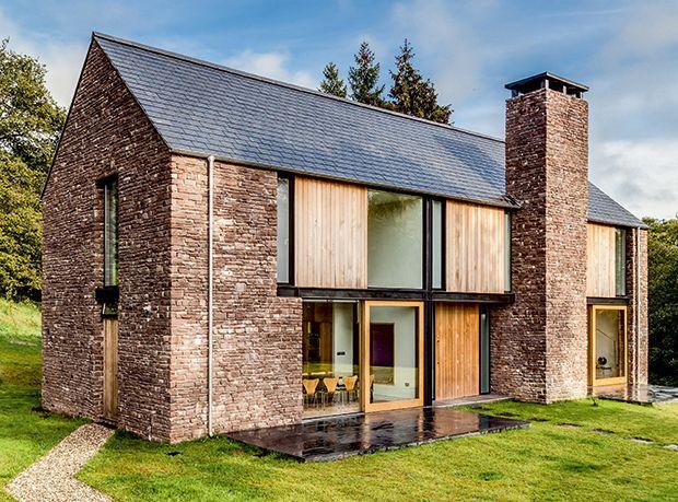 vernacular stone walls on a modern barn style home