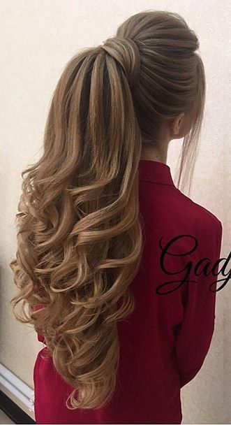 Huge Gorgeous Curls at the end of a pony tail. Rare strategy, but very effective for attention. ;)