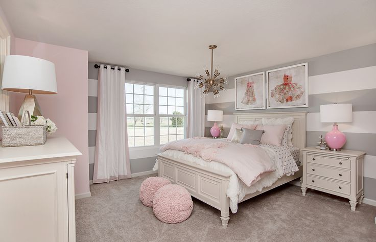 Striped gray walls and pink decor are the perfect match in this beautifully designed girls bedroom. | Pulte Homes