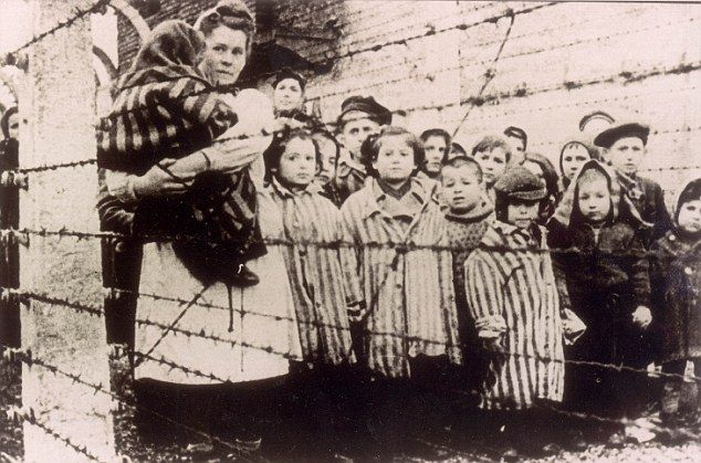 No way out: A woman prisoner with her young Jewish counterparts at Auschwitz. Franz Wunsch was described at his trial by camp survivors as a natural 'Jew Hater'