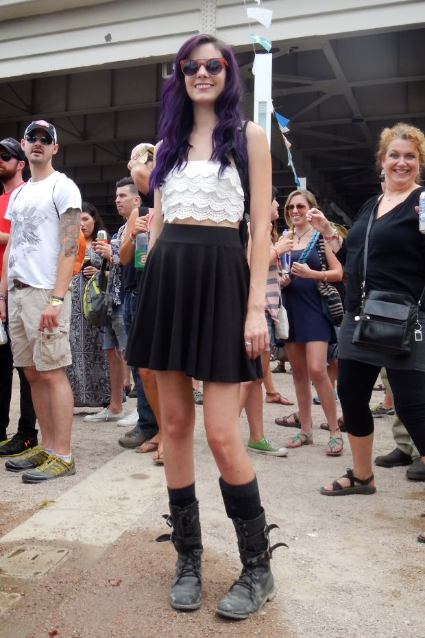 Forecastle festival at Louisville Kentucky.  Purple hair crop top, combat boots, high waisted skirt, round glasses festival fashion.