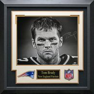 Tom Brady signed Officially licensed, Blue, New England Patriots, home jersey. The authentically signed jersey is matted and framed with three accent images, all showing Brady in action during a game
