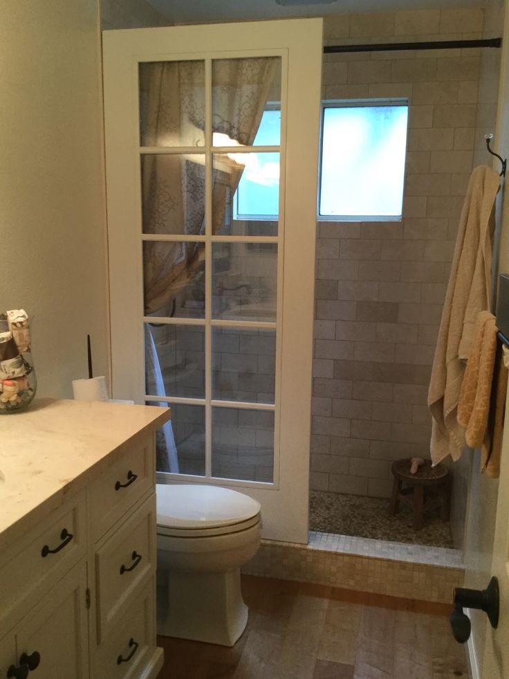Upcycled French door walk-in shower, courtesy #AMSConstructionLivermoreCA